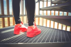 girl in pink running sport shoes
