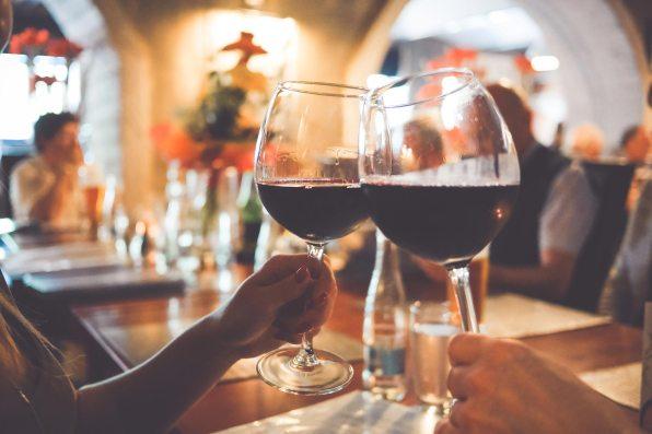 two wine glasses cheers