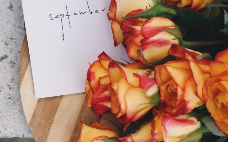 September sign with Flowers