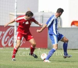 Jaime y Juan Delgado en un lance del partido disputado en la Ciudad Deportiva El Decano