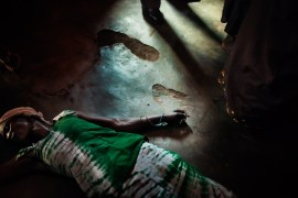 """The Democratic Republic of the Congo, South Kivu, Bukavu. 27th February 2009. A demon-possessed woman fell through the floor during the mass service in a """"Revival Church"""" of Bukavu. Travelling across a country tormented and perennially on the brink of disintegration, this news report tells of the events which fit somewhere between religion and superstition. It investigates the relationship between reality and the escape from it through the unconscious, faith, and the negation of the self. Through the delirious apologia of the Revival Churches, the mysteries unveiled by the sects, by the wafumo sorcerers or the wailing children accused of witchcraft, to arrive at the most expressive fringes of Catholicism."""