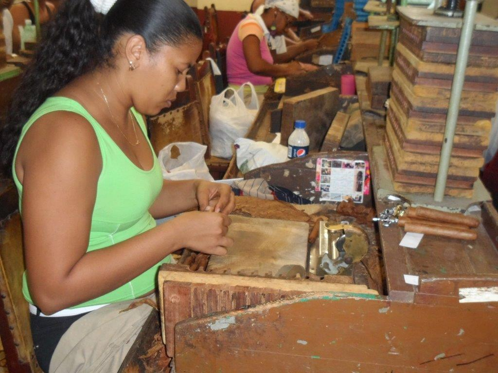 Image result for women hand rolling cuban cigars