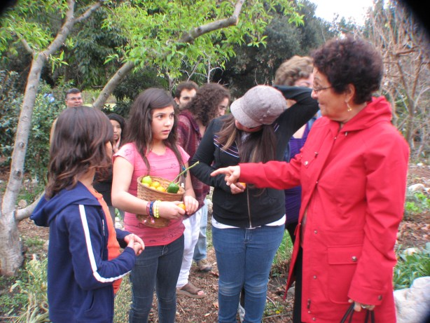 CGIE interns accompany junior youth and children they work with visiting pomona College organic farm in Feb 2012