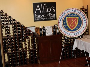 Alfio's wine room with the Chaine emblem