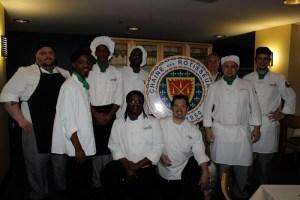 Chef Sean Kagy (center under placard) and the Summit Restaurant staff