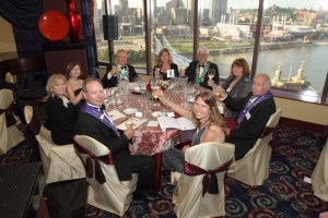 Toast at Bailli's table with Roebling Bridge and Great American Ball Park in background