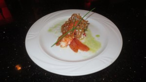Butter poached Maine lobster with ginger glaze, lemon foam, brûléed grapefruit, and basil oil