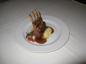 Roasted New Zealand rack of lamb with smashed Yukon gold potatoes, morel mushrooms, caramelized spring onion demi-glace, and tomato garlic caviar
