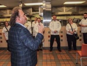Chef Jean-Robert de Cavel addressing the competitors