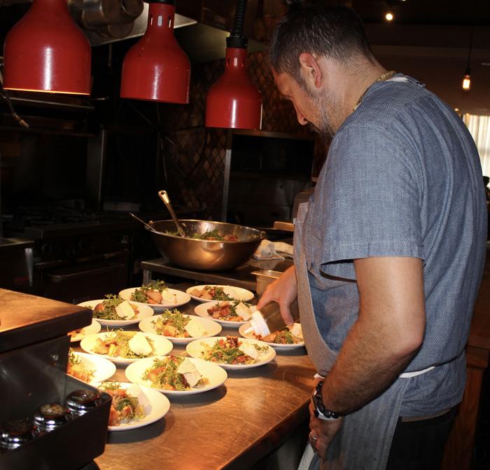 Chef Bernstein finishing Panzanella