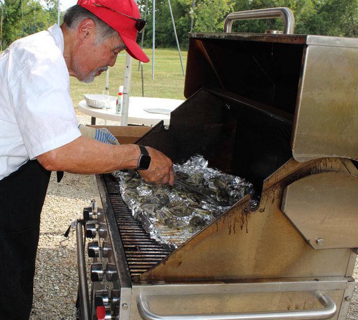 Chef Chuck Hong at the grill