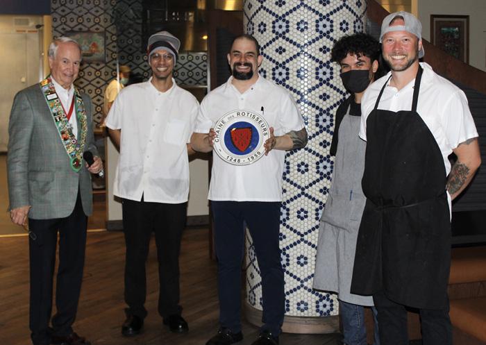 George Elliott presenting Chaine plate to Chef Salazar