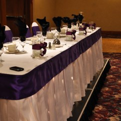 Affordable Chair Covers Calgary Oval Back Chairs Affair Gallery Raddison Hotel White Banquet With Purple Satin Sash The Table Is Accentuated