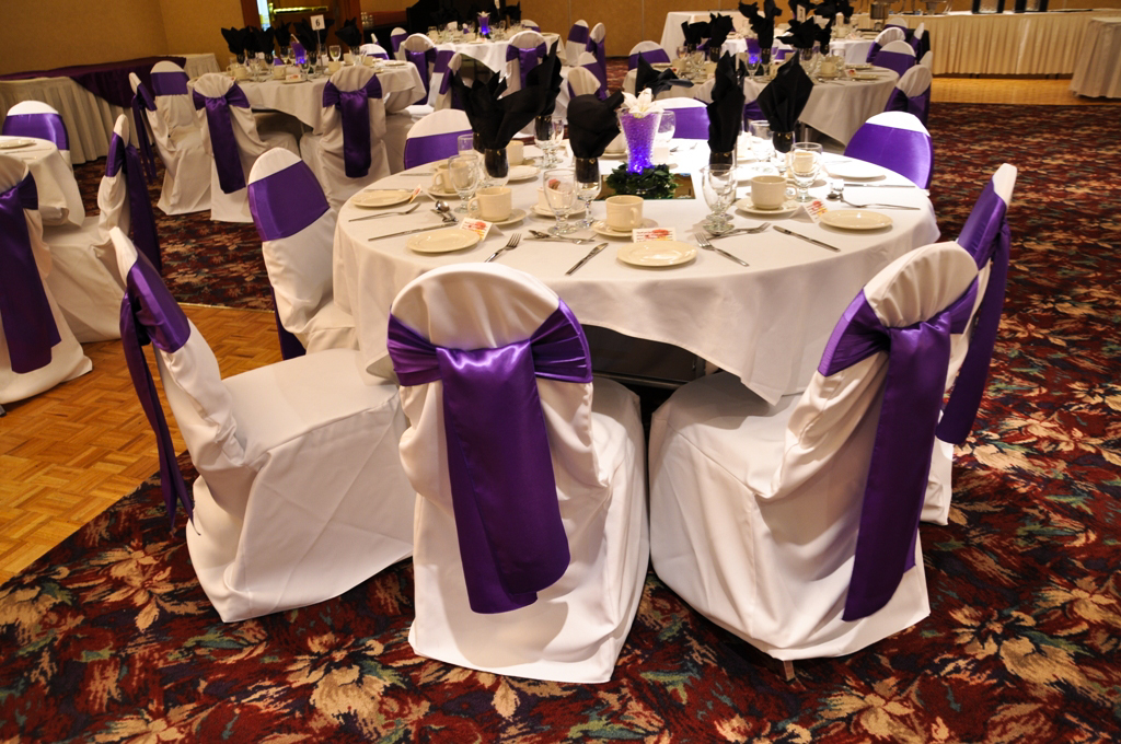 affordable chair covers calgary rattan chairs argos affair gallery raddison hotel white banquet with purple satin sash