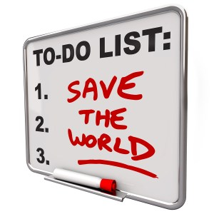 The words Save the World written on a dry erase board to do list