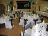 The main hall hosting a wedding reception - Front view