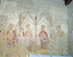 Four Apostles West Wall North Aisle, third from the left holding a cup is possibly St.John.
