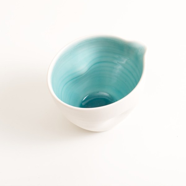 Handmade porcelain pouring bowl small turquoise with tactile dimples. Small or medium size. Inside glazed in a choice of: pale blue, turquoise, pink or grey.