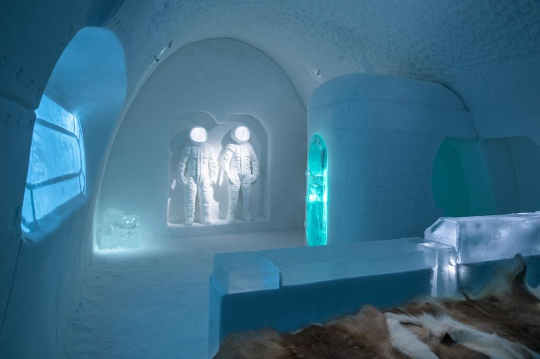 icehotel space room, with frozen ice hotel sculptures
