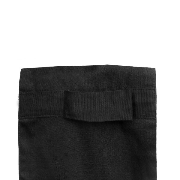 The strap detail on the double oven glove by The Organic Company on Chalk & Moss. Shown in black, it's also available in light or dark grey.