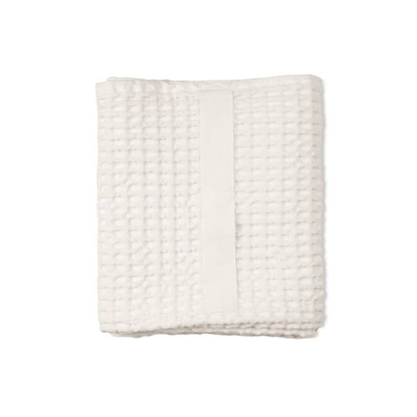 Waffle towels designed by The Organic Company. This soft and absorbent medium sized towel is available in a range of soft colours with a Scandinavian feel. Shown here in white.