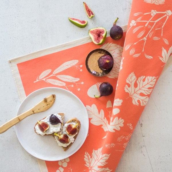 Winter leaves on this peach coloured tea towel, by Softer + Wild. Available on chalkandmoss.com.