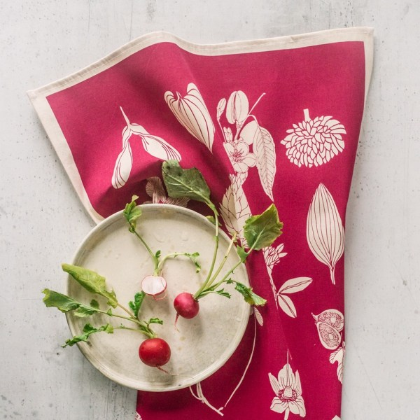 Botanical tea towel in natural, un-dyed cotton by Softer + Wild. Hand screen printed in Sussex UK. Available in many vibrant colours, seen here in raspberry red. Available at Chalk & Moss - chalkandmoss.com
