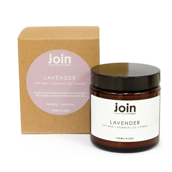Lavender candle hand crafted in London in small batches. Made from 100% vegan soy wax and high quality pure essential oil. Lavender is a traditional aromatherapy treatment for anxiety, stress and sleep. Its warm glow creates a soothing aroma. Seen here is the recycled kraft packaging used for these brown glass jar candles.