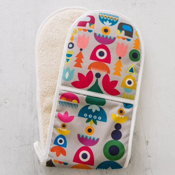 """Solstice double oven glove inspired by Scandinavian 1970s shapes and Eastern European patterns. 84x20cm. 100% cotton with towelling back, heat resistant. Available in two colour ways. This is the """"Bright"""" design."""