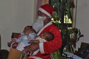Santas hands full