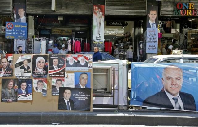 Des affiches de candidats aux élections législatives, à Damas (Syrie) le 15 juillet 2020 (AFP/Archives - LOUAI BESHARA)