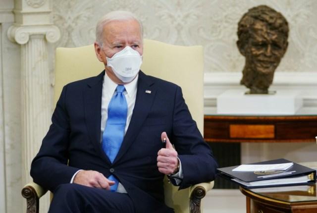Le président américain Joe Biden dans le Bureau Ovale de la Maison Blanche, le 12 février 2021 à Washington (AFP - MANDEL NGAN)