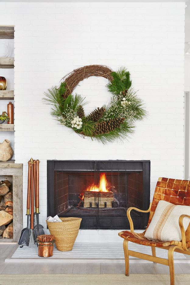 winter wreath over fire place