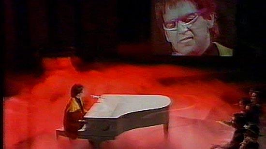 Rob Sitch as Elton John
