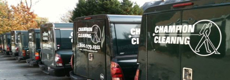 Fleet of Champion Cleaning trucks