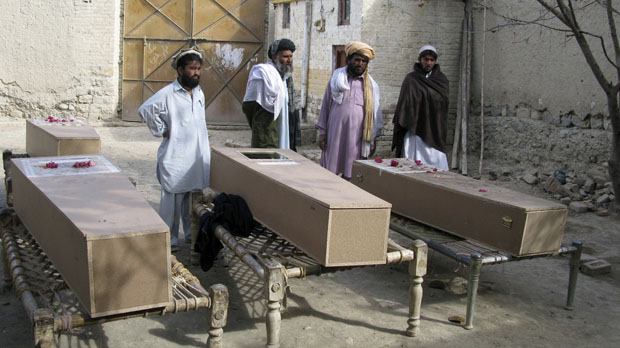 Residents stand near the coffins of victims of a missile attack in Mir Ali on the outskirts of Miranshah near the Afghan border in January 2009 following a suspected US droneb attack. (Reuters)