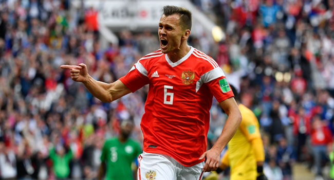 Russia's midfielder Denis Cheryshev celebrates after scoring the second goal during the