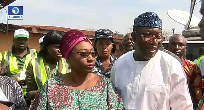 Kayode Fayemi and his wife at the polling unit on Saturday, July 14, 2018.