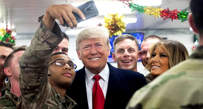 Troops Take Selfies With Trump, Melania In Unannounced Iraq Visit