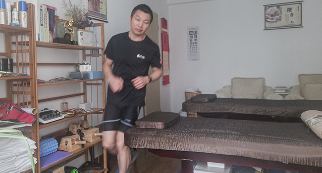 This handout picture taken and released courtesy of Pan Shancu on February 14, 2020 shows Pan Shancu running in his bedroom in Hangzhou, China's eastern Zhejiang province. Handout / Pan Shancu / AFP