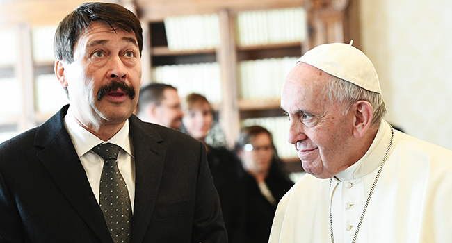 Hungarian President Janos Ader (L) gestures as he meets with Pope Francis during a private audience at the Vatican, on February 14, 2020. Vincenzo PINTO / POOL / AFP