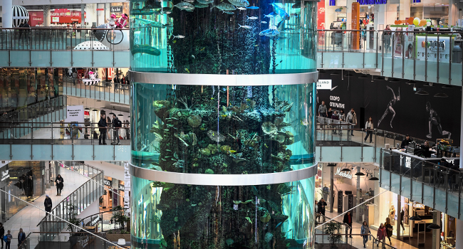 Visitors walk around a huge aquarium in Aviapark shopping mall in Moscow on February 18, 2020.