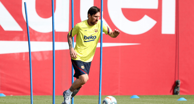 This handout pictured made available by FC Barcelona shows Barcelona's Argentine forward Lionel Messi attending a training session at the Ciutat Esportiva Joan Gamper in Sant Joan Despi on May 8, 2020.  Miguel RUIZ / AFP / FC BARCELONA