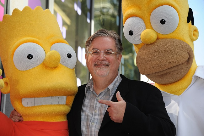 "(FILES) In this file photo taken on February 14, 2012 Cartoonist Matt Groening, creator of ""The Simpsons,"" poses with his characters Bart (L) and Homer Simpson as he is honored with the 2,459th star on the Hollywood Walk of Fame in Hollywood. - The producers of The Simpsons, the world-famous animated series, announced June 26 that they will no longer use white actors to dub ethnic minority characters. (Photo by Robyn BECK / AFP)"