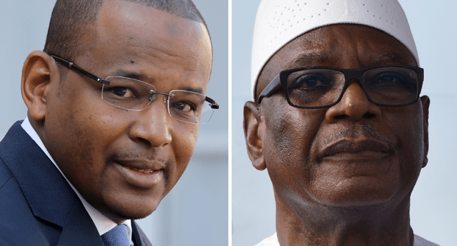 A combination of file pictures created on August 18, 2020 in Paris shows Malian Prime Minister Boubou Cisse (L) leaving the Elysee Palace after a meeting with the French president on September 10, 2019 in Paris, and Malian President Ibrahim Boubacar Keita (R) pictured during his arrival at Felix Houphouet Boigny Airport in Abidjan for a visit on May 10, 2018.  Sia KAMBOU, Ludovic MARIN / AFP