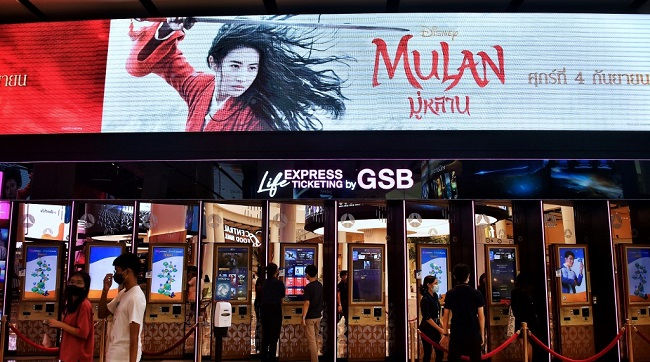 People buy tickets for Disney's Mulan film at a cinema inside a shopping mall in Bangkok on September 8 2020.