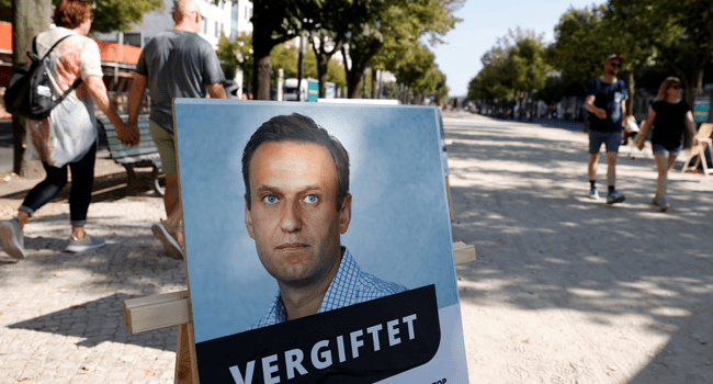 A poster with a picture of Russian opposition leader Alexei Navalny with the headline