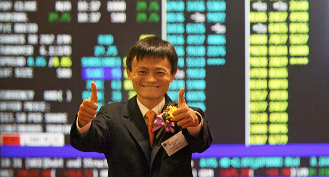 This file photo taken on November 6, 2007 shows Jack Ma, founder and chairman of Alibaba.com, giving a thumbs up to the press at the Hong Kong Stock Exchange in Hong Kong. Mike CLARKE / AFP