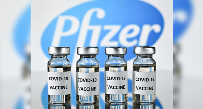An illustration picture shows vials with Covid-19 Vaccine stickers attached, with the logo of US pharmaceutical company Pfizer, on November 17, 2020. JUSTIN TALLIS / AFP