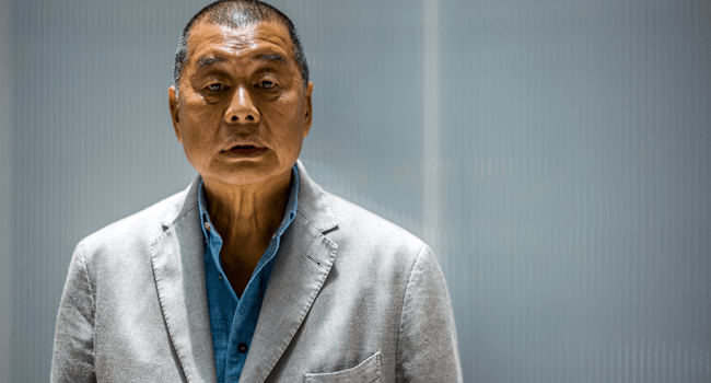 In this file photo taken on June 16, 2020, millionaire media tycoon Jimmy Lai, 72, poses during an interview with AFP at the Next Digital offices in Hong Kong. Anthony WALLACE / AFP